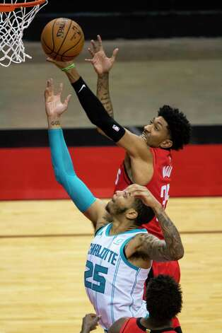 Houston Rockets center Christian Wood (35) shoots over Charlotte Hornets forward P.J. Washington (25) during the third quarter of an NBA game between the Houston Rockets and Charlotte Hornets on Wednesday, March 24, 2021, at Toyota Center in Houston. Photo: Mark Mulligan, Staff Photographer / © 2021 Mark Mulligan / Houston Chronicle