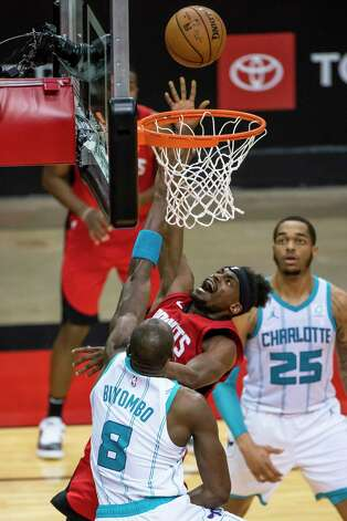 Houston Rockets forward Danuel House Jr. (4) shoots over Charlotte Hornets center Bismack Biyombo (8) during the third quarter of an NBA game between the Houston Rockets and Charlotte Hornets on Wednesday, March 24, 2021, at Toyota Center in Houston. Photo: Mark Mulligan, Staff Photographer / © 2021 Mark Mulligan / Houston Chronicle