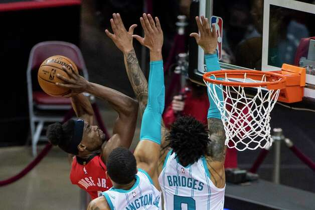 Houston Rockets forward Danuel House Jr. (4) shoots over Charlotte Hornets forward Miles Bridges (0) during the second quarter of an NBA game between the Houston Rockets and Charlotte Hornets on Wednesday, March 24, 2021, at Toyota Center in Houston. Photo: Mark Mulligan, Staff Photographer / © 2021 Mark Mulligan / Houston Chronicle