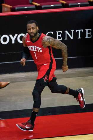 Houston Rockets guard John Wall (1) runs down court after hitting a three point shot during the second quarter of an NBA game between the Houston Rockets and Charlotte Hornets on Wednesday, March 24, 2021, at Toyota Center in Houston. Photo: Mark Mulligan, Staff Photographer / © 2021 Mark Mulligan / Houston Chronicle