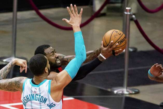 Houston Rockets guard John Wall (1) shoots around Charlotte Hornets forward P.J. Washington (25) during the second quarter of an NBA game between the Houston Rockets and Charlotte Hornets on Wednesday, March 24, 2021, at Toyota Center in Houston. Photo: Mark Mulligan, Staff Photographer / © 2021 Mark Mulligan / Houston Chronicle