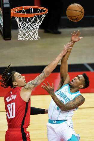 Houston Rockets forward D.J. Wilson (00) tries to stop a shot by Charlotte Hornets guard Malik Monk (1) during the second quarter of an NBA game between the Houston Rockets and Charlotte Hornets on Wednesday, March 24, 2021, at Toyota Center in Houston. Photo: Mark Mulligan, Staff Photographer / © 2021 Mark Mulligan / Houston Chronicle