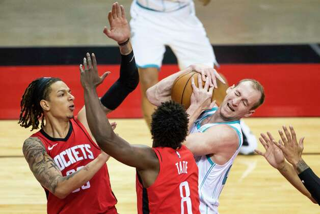 Charlotte Hornets center Cody Zeller (40) pulls down a rebound from Houston Rockets forward D.J. Wilson (00) and Houston Rockets forward Jae'Sean Tate (8) during the second quarter of an NBA game between the Houston Rockets and Charlotte Hornets on Wednesday, March 24, 2021, at Toyota Center in Houston. Photo: Mark Mulligan, Staff Photographer / © 2021 Mark Mulligan / Houston Chronicle