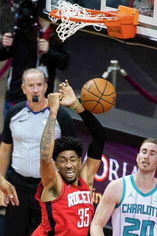 Houston Rockets center Christian Wood (35) dunks during the first quarter of an NBA game between the Houston Rockets and Charlotte Hornets on Wednesday, March 24, 2021, at Toyota Center in Houston. Photo: Mark Mulligan, Staff Photographer / © 2021 Mark Mulligan / Houston Chronicle