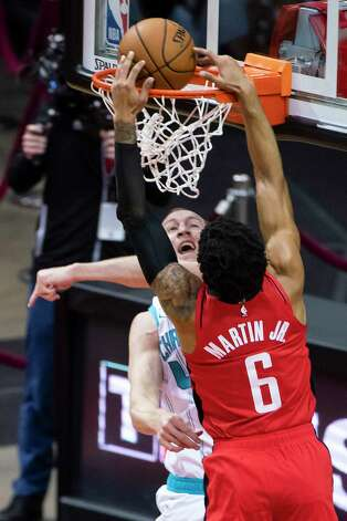 Charlotte Hornets center Cody Zeller (40) tries to defend a shot by Houston Rockets forward Kenyon Martin Jr. (6) during the second quarter of an NBA game between the Houston Rockets and Charlotte Hornets on Wednesday, March 24, 2021, at Toyota Center in Houston. Photo: Mark Mulligan, Staff Photographer / © 2021 Mark Mulligan / Houston Chronicle