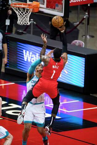 Houston Rockets guard John Wall (1) shoots during the first quarter of an NBA game between the Houston Rockets and Charlotte Hornets on Wednesday, March 24, 2021, at Toyota Center in Houston. Photo: Mark Mulligan, Staff Photographer / © 2021 Mark Mulligan / Houston Chronicle