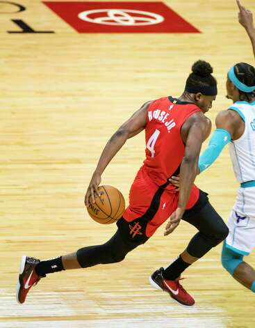 Houston Rockets forward Danuel House Jr. (4) runs down court and is fouled on a fast break during the first quarter of an NBA game between the Houston Rockets and Charlotte Hornets on Wednesday, March 24, 2021, at Toyota Center in Houston. Photo: Mark Mulligan, Staff Photographer / © 2021 Mark Mulligan / Houston Chronicle