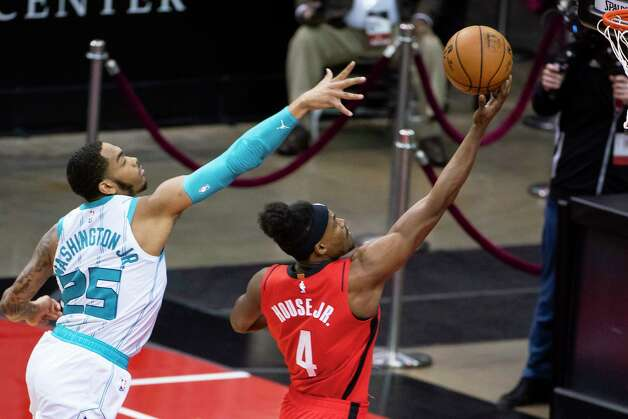 Charlotte Hornets forward P.J. Washington (25) tries to stop a shot by Houston Rockets forward Danuel House Jr. (4) during the first quarter of an NBA game between the Houston Rockets and Charlotte Hornets on Wednesday, March 24, 2021, at Toyota Center in Houston. Photo: Mark Mulligan, Staff Photographer / © 2021 Mark Mulligan / Houston Chronicle