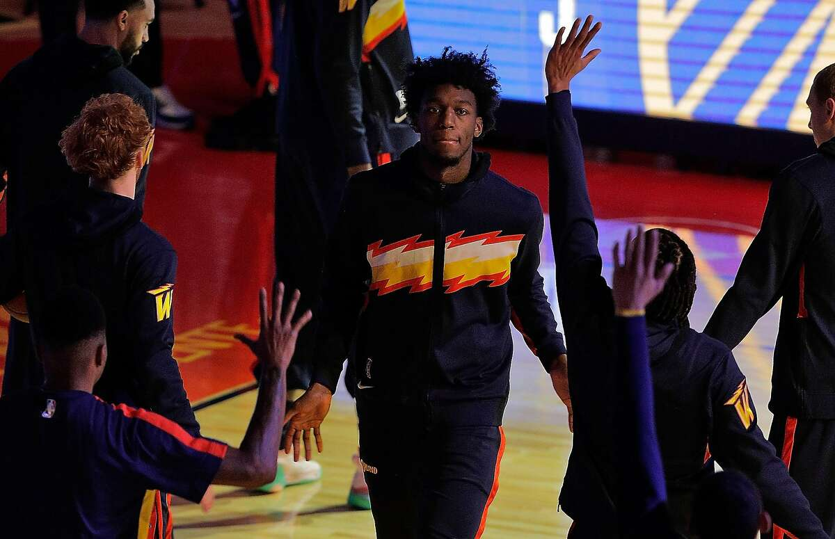 James Wiseman high fives teammates during pregame intros before the game between the Golden State Warriors and the Philadelphia 76ers at Chase Center in San Francisco, Calif., on Tuesday, March 23, 2021.