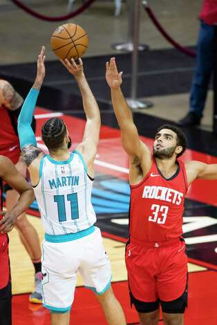 Houston Rockets forward Anthony Lamb (33) defends a shot by Charlotte Hornets forward Cody Martin (11) during the fourth quarter of an NBA game between the Houston Rockets and Charlotte Hornets on Wednesday, March 24, 2021, at Toyota Center in Houston. Photo: Mark Mulligan, Staff Photographer / © 2021 Mark Mulligan / Houston Chronicle