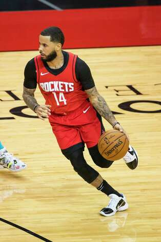 Houston Rockets guard D.J. Augustin (14) drives during the fourth quarter of an NBA game between the Houston Rockets and Charlotte Hornets on Wednesday, March 24, 2021, at Toyota Center in Houston. Photo: Mark Mulligan, Staff Photographer / © 2021 Mark Mulligan / Houston Chronicle