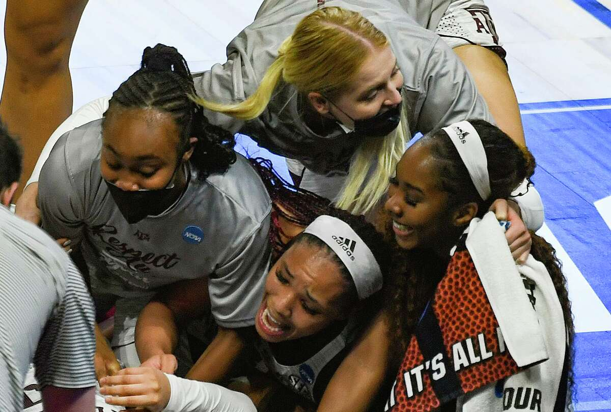 Texas A&M players celebrate their 84-82 overtime victory over Iowa State in the NCAA Women's Basketball Championship tournament to advance to the Sweet 16 in in the Alamodome on Wednesday, March 24, 2021.