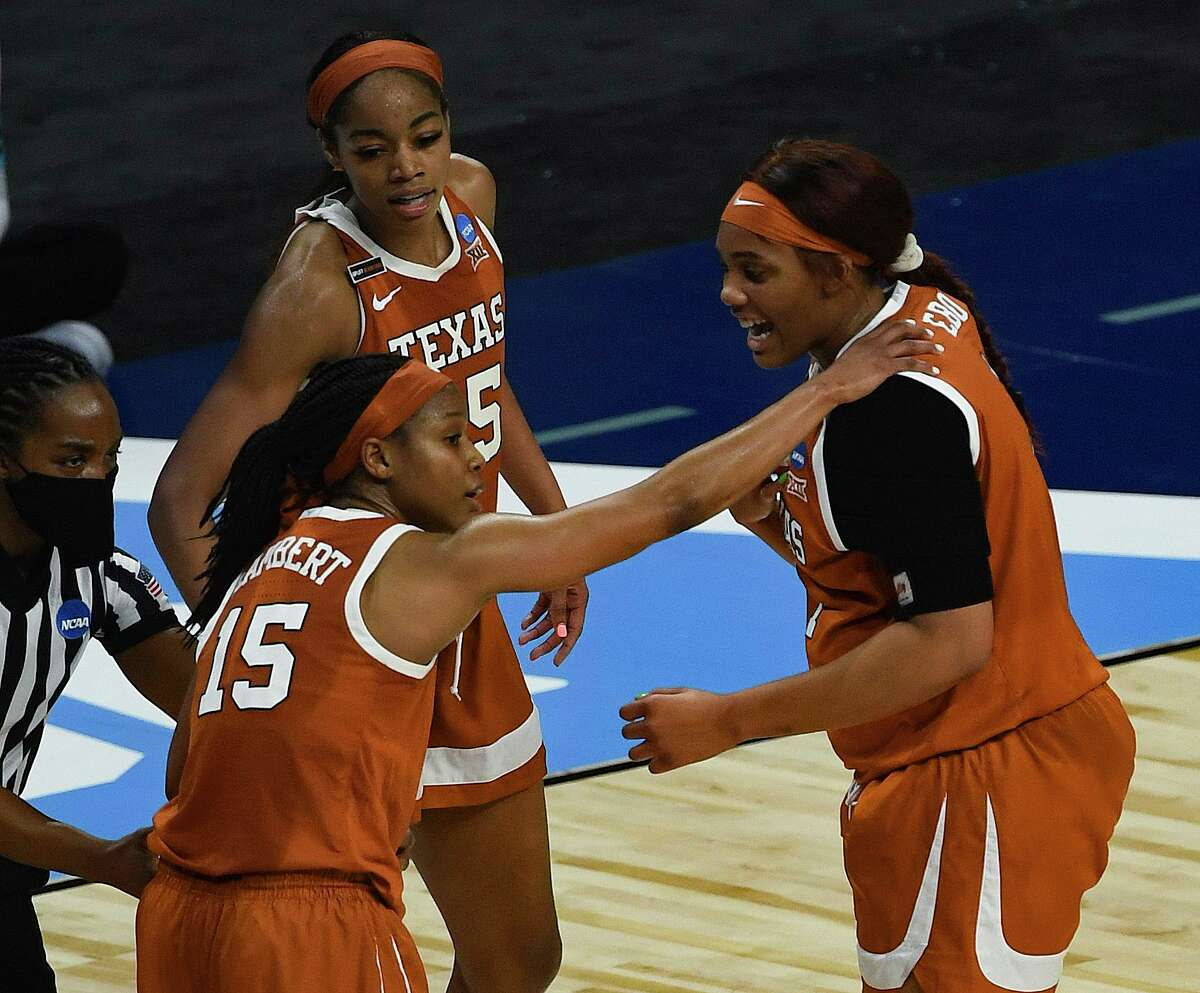 Kyra Lambert (15), Charli Collier, middle, and Lauren Ebo of Texas encourage one another Wednesday against UCLA.