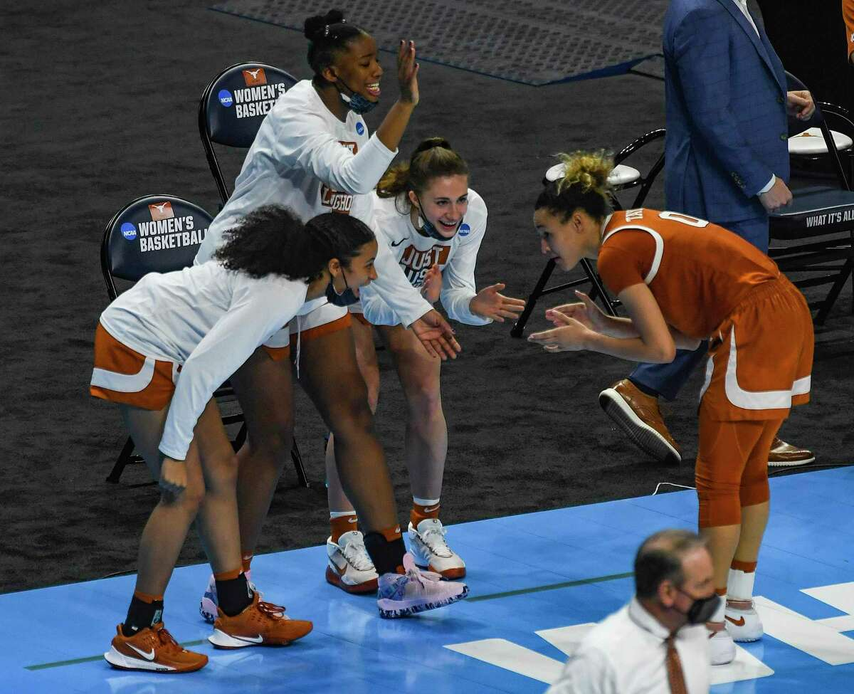 Celeste Taylor bows to teammates as time winds down on the Longhorns 71-62 victory over UCLA in the second round of the NCAA Women's Basketball Championship tournament in the Alamodome on Wednesday, March 24, 2021.