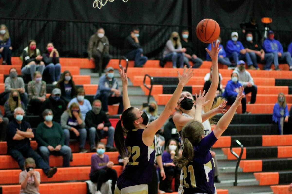 Mairin McCarthy goes up with a contested shot in the paint during the Portagers' loss to Frankfort in districts on March 24. (Robert Myers/Record Patriot)