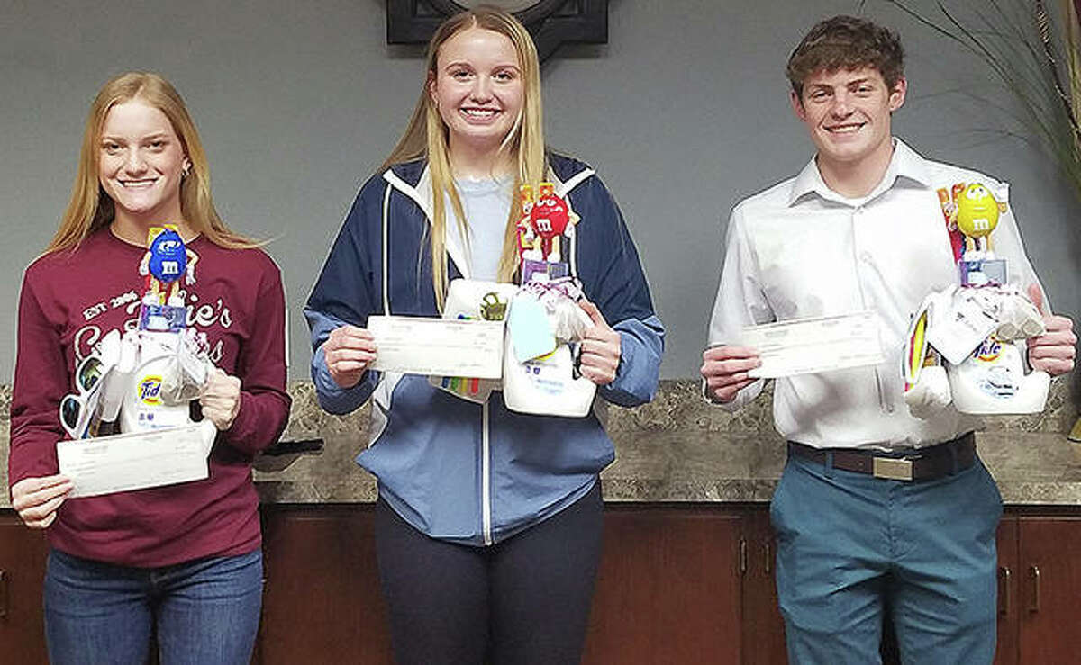 Jersey State Bank has honored Kaylee Vahle (from left), Boston Talley and Cole Spencer in this year's essay scholarship contest.