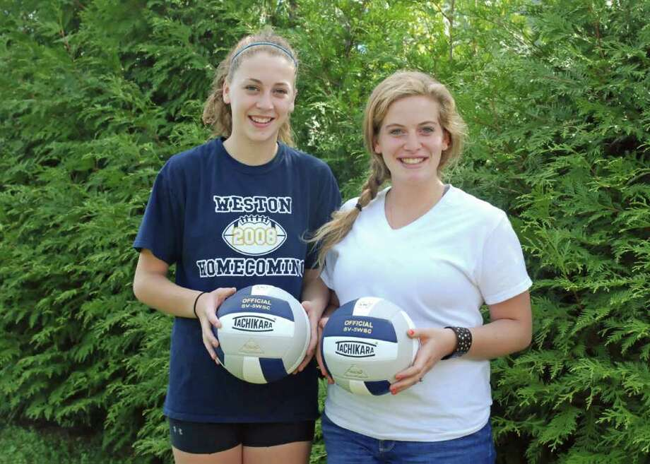 Weston senior volleyball captains Christina Welsh, left, and Maggie Montelli aim to lead the Lady Trojans deep into the SWC and Class M playoffs. Photo: Contributed Photo / Steven Gersh