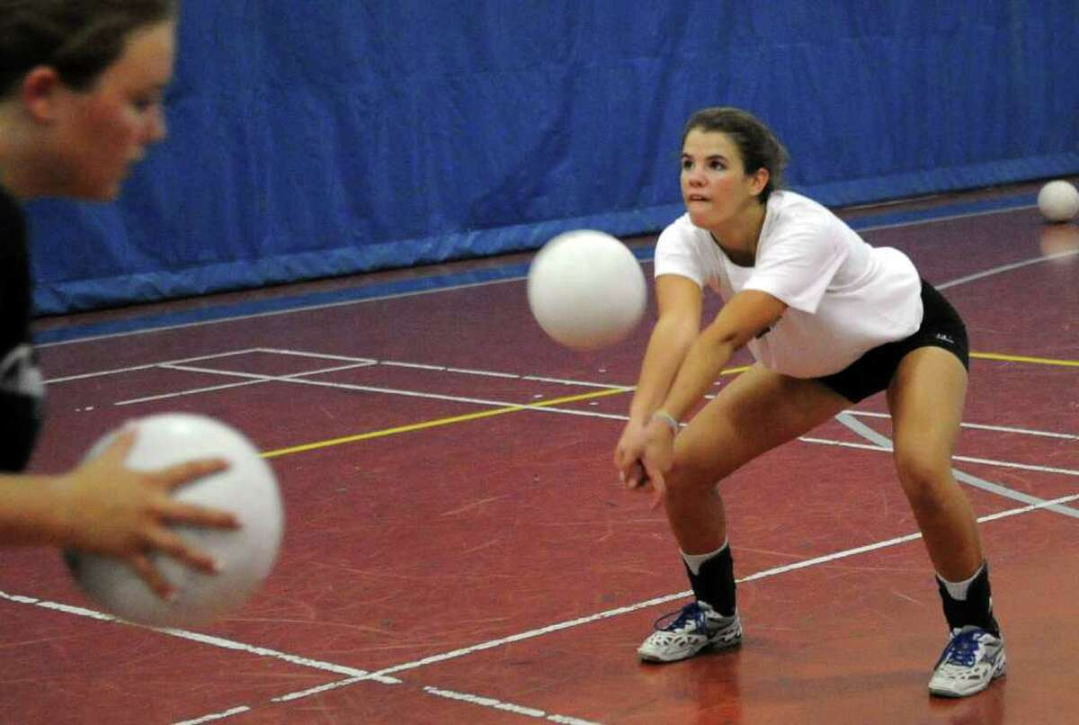 Alex Masiello bumps the ball, during volleyball practice at Staples High in Westport, Conn. on Thursday September 2, 2010.