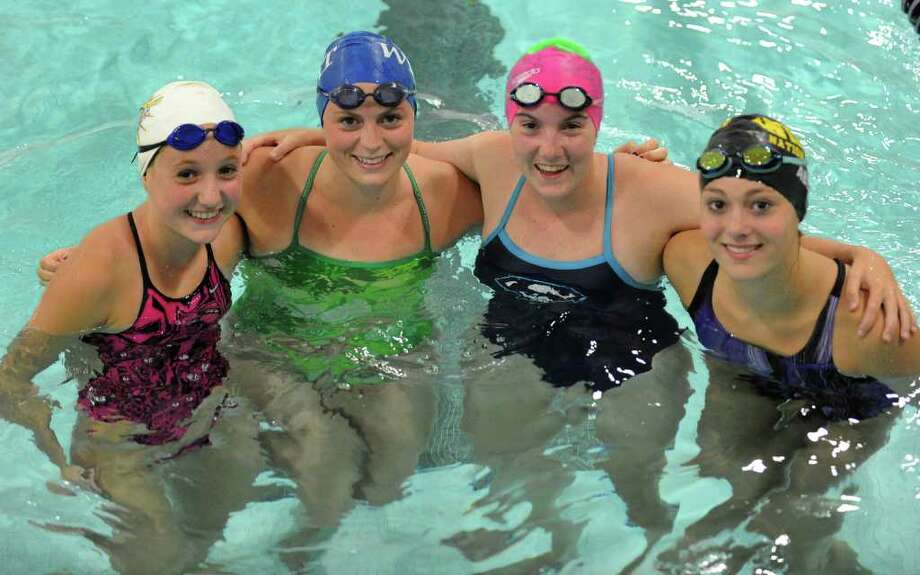 From left to right is Gabbie Lebline, Molly Loftus, Caitlin Wiederecht, and Verity Abel, during swimming practice at Staples High in Westport, Conn. on Thursday September 2, 2010. Photo: Christian Abraham / Connecticut Post