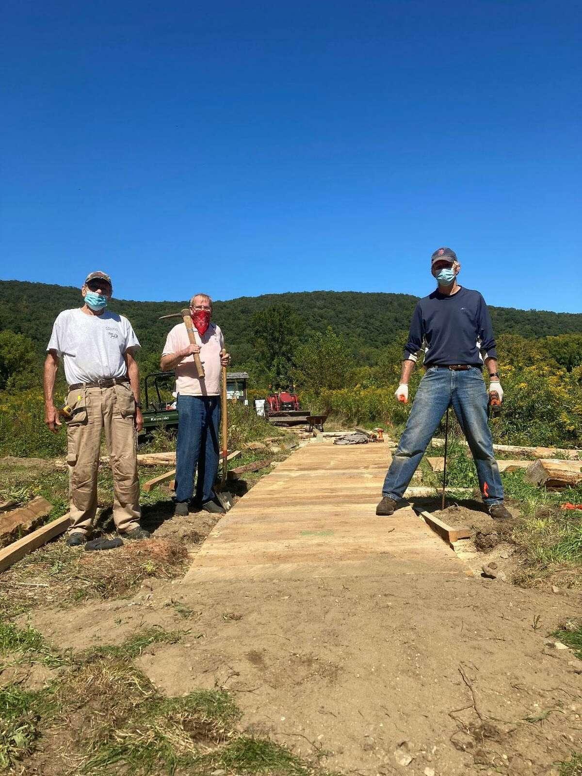 Volunteers help build a new boardwalk at Macricostas Preserve in 2020.