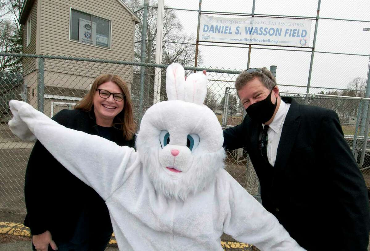 The Easter Bunny poses with Tracy Bonosconi, President of the Downtown Milford Business Alliance, left, and Radio Personality and DMBA board member Brian Smith at Wasson Field in Milford, Conn., on Wednesday March 24, 2021. DMBA will hold its first ever Easter Eggstravaganza event on March 27th from 9 a.m. to 3 p.m. According to the event's flyer on Facebook, activities include a socially-distant professional photograph with the Easter Bunny taken by A.G. Productions, an 8?-10 print courtesy of Milford Photo, a goody bag filled with Easter-themed treats, hair braiding by E'LAN by Dominique Renee, and a free Easter Egg Trail through participating downtown shops.