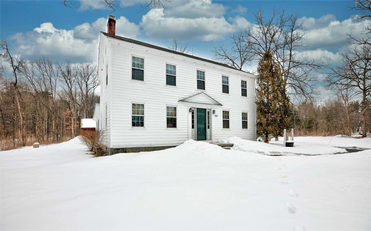 This house was built as a tavern 230 years ago, but has mostly been a family home throughout its long history. The style is Colonial, and the setting is agricultural. The property is five acres and includes two barns. Changes over the years have added space, a three-season room, a kitchen with quartz counters and updated bathrooms, but the two fireplaces, plank floors and doors made with mortise and tenon joints are still there. The house has two and a half bathrooms and four bedrooms. Natural gas heat, private septic and well. South Glens Falls schools. Taxes: $5,710. List price: $378,000. Contact listing agent Scott Varley at Keller Williams Capital District at 518-281-6808. https://realestate.timesunion.com/listings/251-Gansevoort-Rd-Moreau-NY-12831-MLS-202112478/49445051