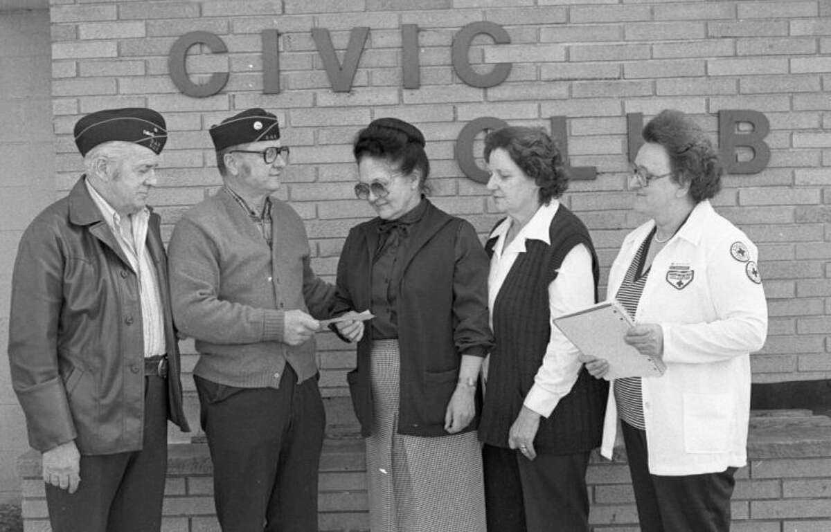The Manistee County Chapter of the American Red Cross received some support recently in the form a check from the Disabled American Veterans and its women's auxiliary. The $20 was meant to help cover expenses and was given to Red Cross Director Charlotte Hughes (center) by DAV Commander Clarence Jerumbo (second from left). Looking on (from left) are DAV Adjutant Chuck Miller, DAV Auxiliary Community Services Chairperson Rose Miller and (far right) Bernadine Jerumbo, Red Cross volunteer chairperson. The photo was published in the News Advocate onMarch 26, 1981.