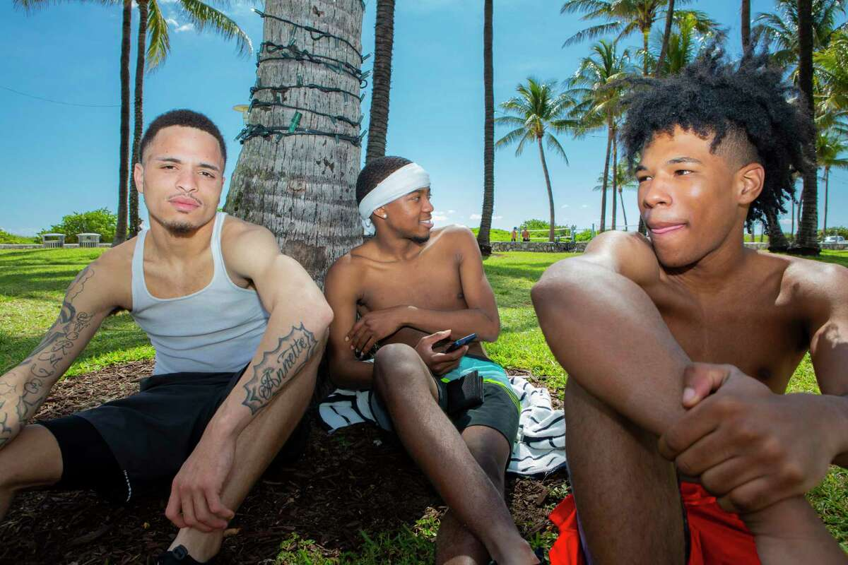 From left, Andre Johnson, 20, Twon Clarke, 20, and Tyquan Johnson, 19, were in Miami Beach during spring break this week.