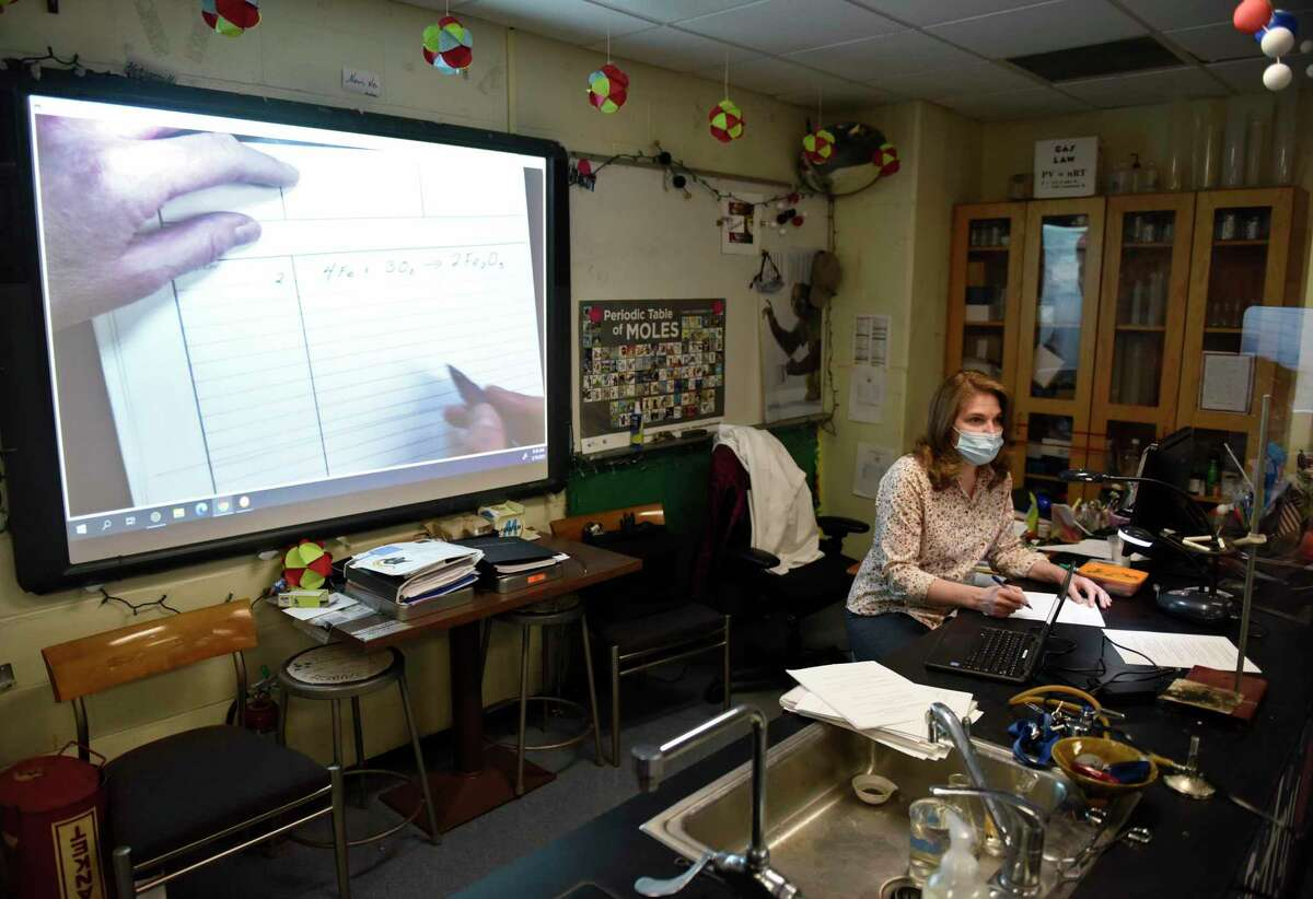 Science teacher Donna Kaiser teaches a class at Stamford High School in Stamford, Conn. Thursday, March 18, 2021. Kaiser was chosen as Stamford's Teacher of the Year and will be honored along with other finalists at the Excellence in Education Awards event on March 25.