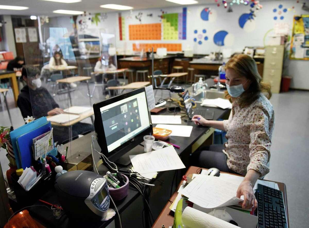 A Stamford High School teacher leads a class in Stamford, Conn. Thursday, March 18, 2021.