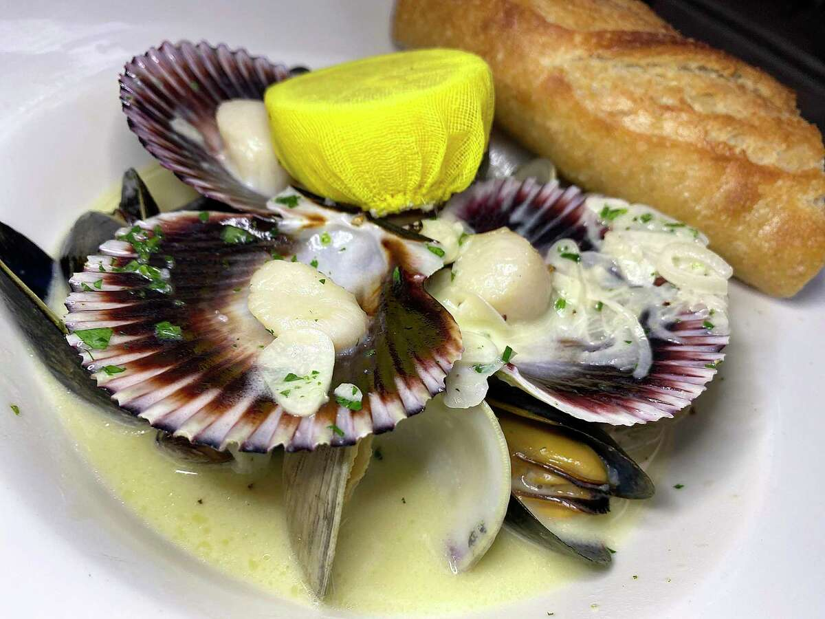Coquillages a la Normande brings together scallops, mussels and clams in garlic cream sauce at Brasserie Mon Chou Chou.
