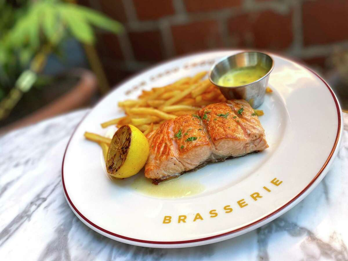 Salmon comes with bearnaise sauce and frites at Brasserie Mon Chou Chou, the new French restaurant at the Pearl.