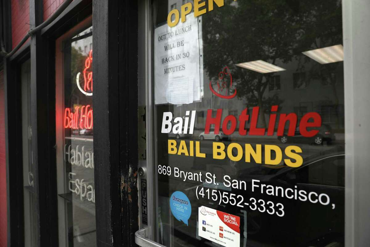 Signage for Bail HotLine bail bonds located across the street from the San Francisco Hall of Justice.