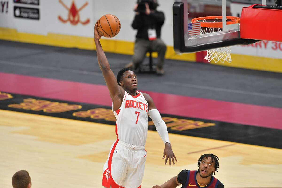 Victor Oladipo of the Houston Rockets shoots over Darius Garland #10 of the Cleveland Cavaliers during the fourth quarter at Rocket Mortgage Fieldhouse on February 24, 2021 in Cleveland, Ohio.