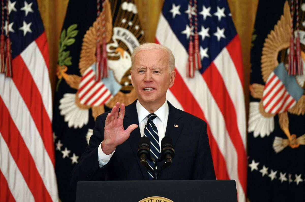 """US President Joe Biden answers a question during his first press briefing in the East Room of the White House in Washington, DC, on March 25, 2021. - Biden said Thursday that the United States will """"respond accordingly"""" if North Korea escalates its missile testing. (Photo by Jim WATSON / AFP) (Photo by JIM WATSON/AFP via Getty Images)"""