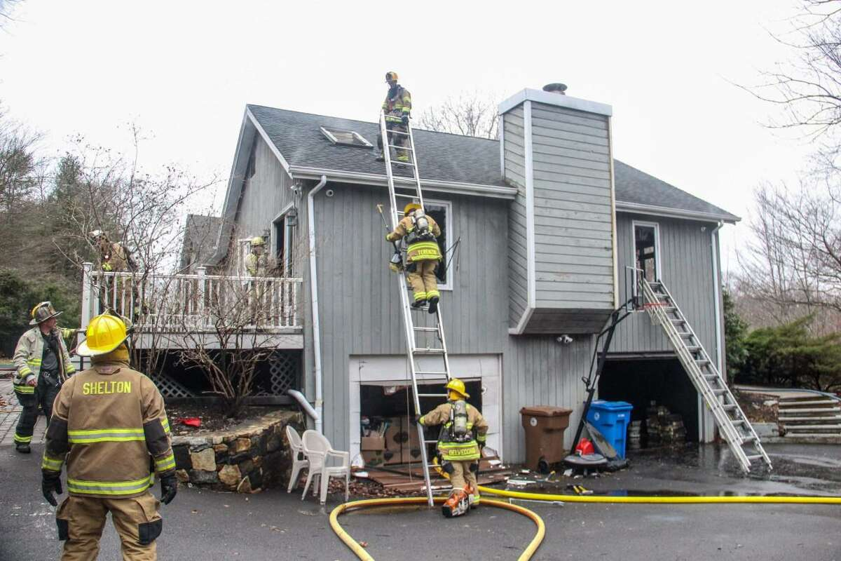 Shelton firefighters battled a blaze at a Mulberry Lane home on Thursday, March 25.