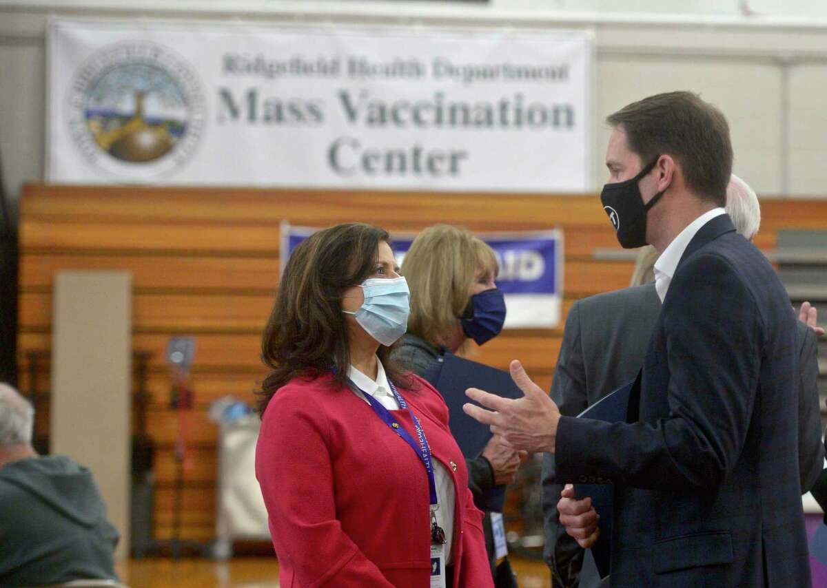 U.S. Representative Jim Himes, right, talks with Theresa Santoro, President and CEO of RVNA Health, during a visit to Ridgefield's vaccination clinic on March 25.