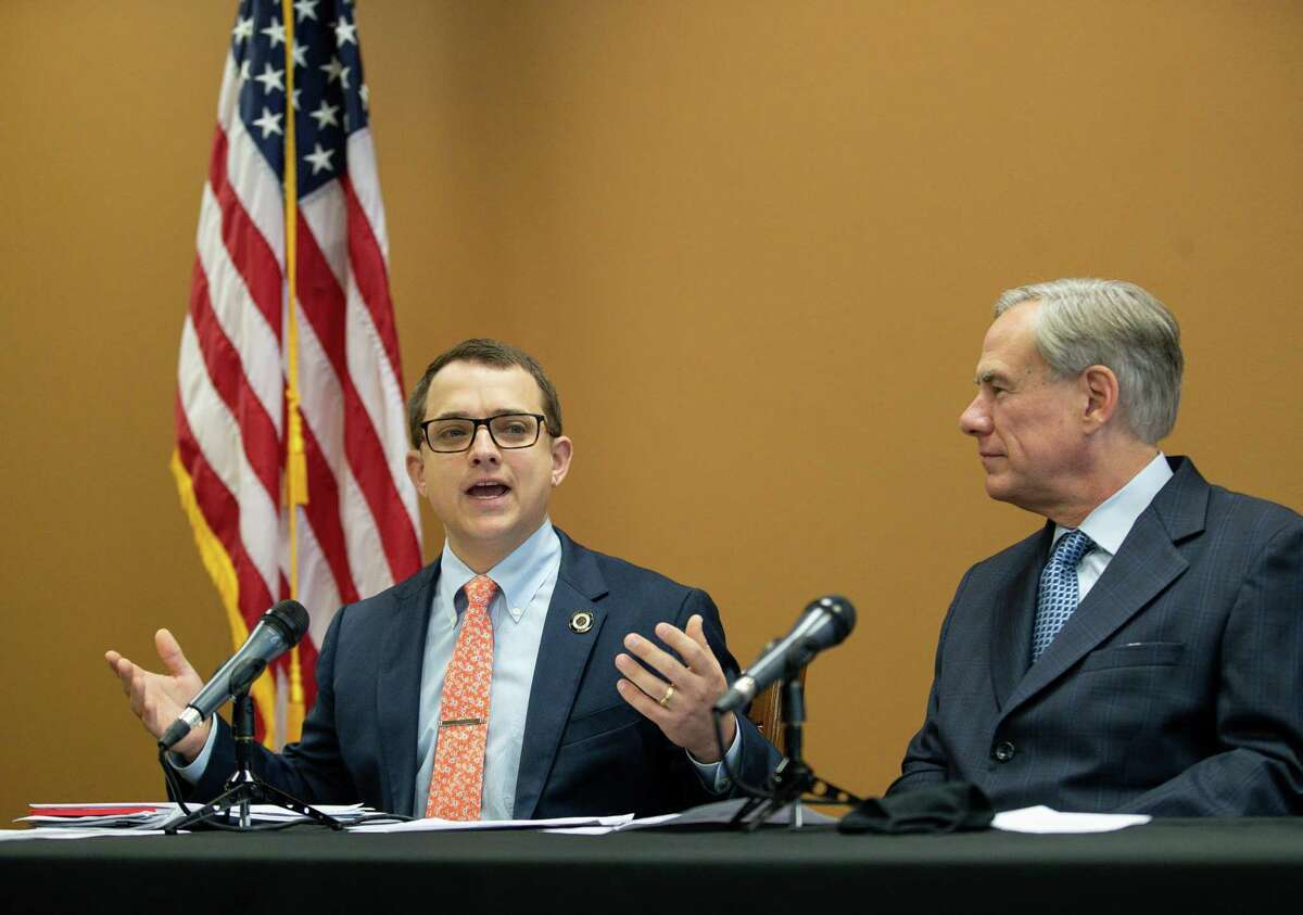 Representative Briscoe Cain, left, talks during a press conference about a package of election reforms, at Senator Paul Bettencourt's District Office on Monday, March 15, 2021, in Houston.
