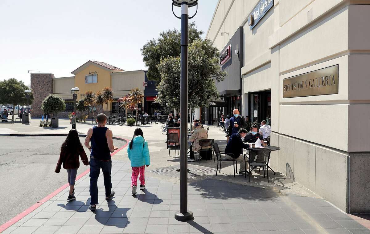 Pedestrians walk along a promenade that will be converted into a pedestrian mall at Stonestown Galleria if plans are approved.
