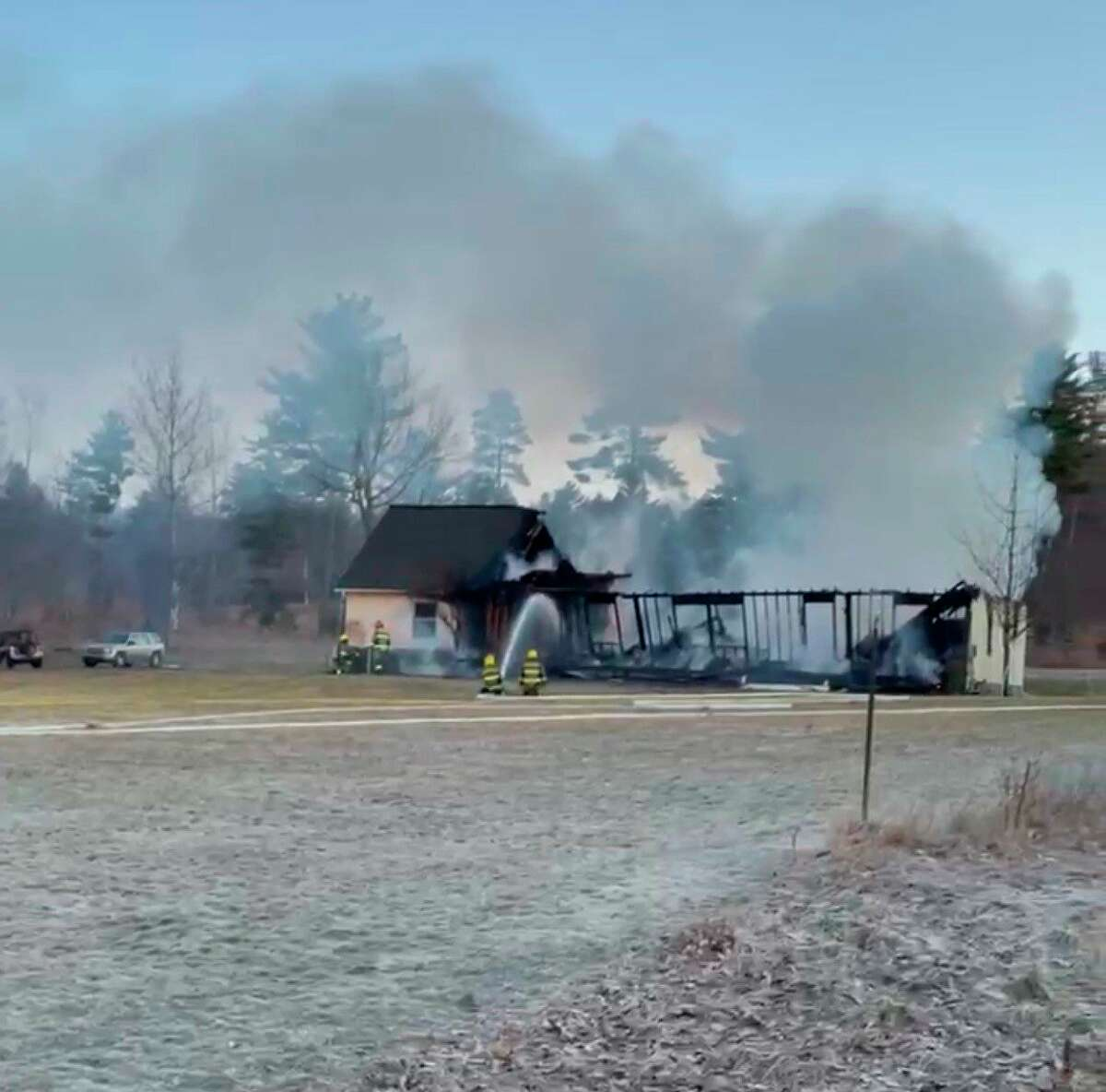 Fire consumed a home on Opal Ridge Drive in Onekama on Saturday. A GoFundMe has been set up to help the homeowners rebuild. (Courtesy Photo/Kara Klein)