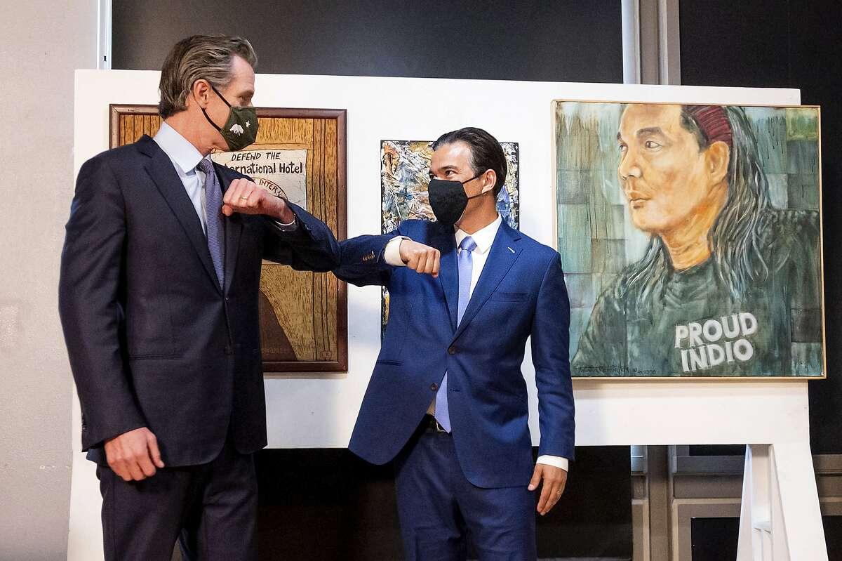 Gov. Gavin Newsom bumps elbows with Assemblyman Rob Bonta, D-Alameda, his choice for attorney general.