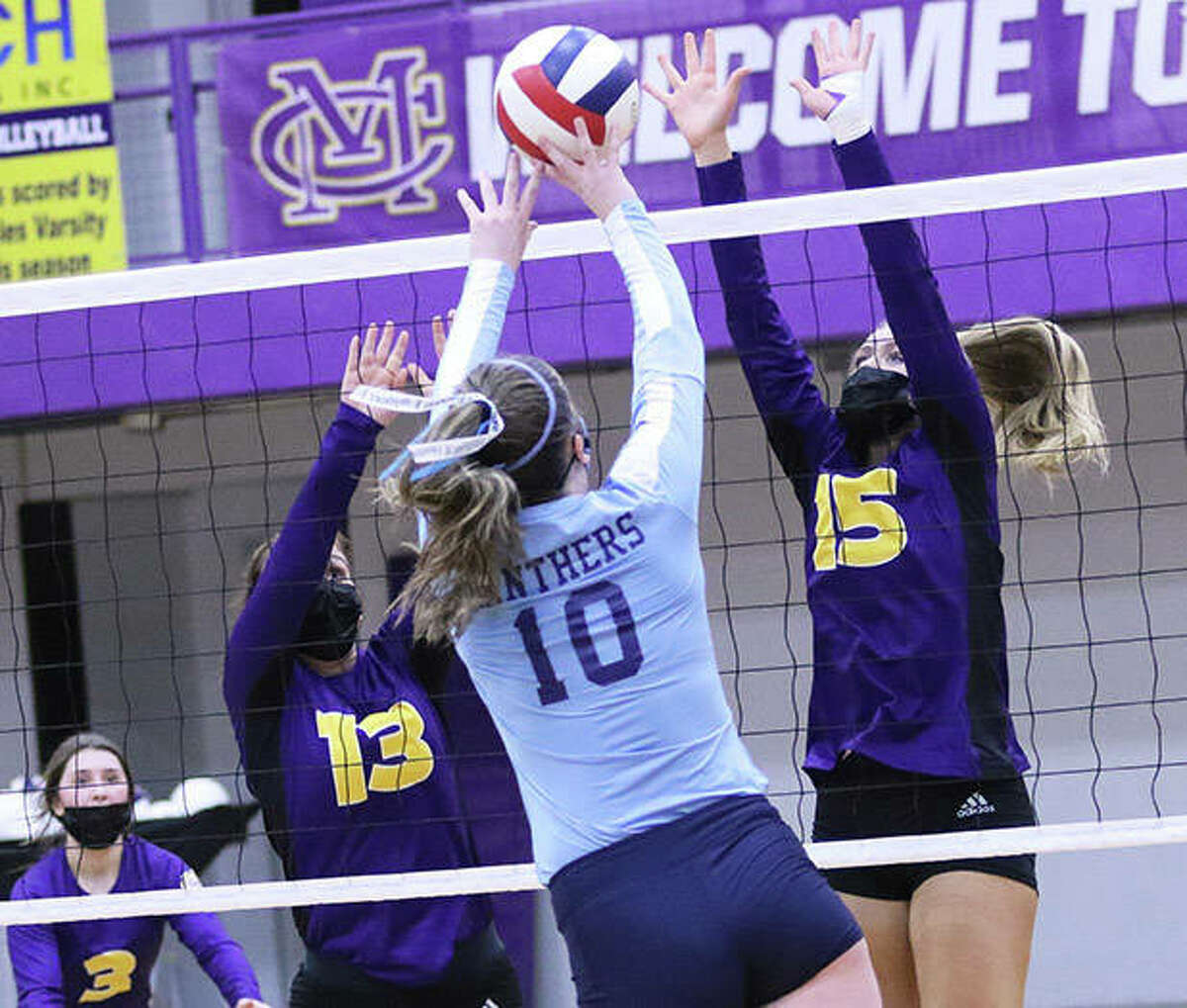 CM's Annabelle Reno (15) puts up a block in front of Jersey's Caroline Gibson (10) while the Eagles' Harper Buhs and Maddie Brueckner (3) watch the play in a March 18 match in Bethalto.