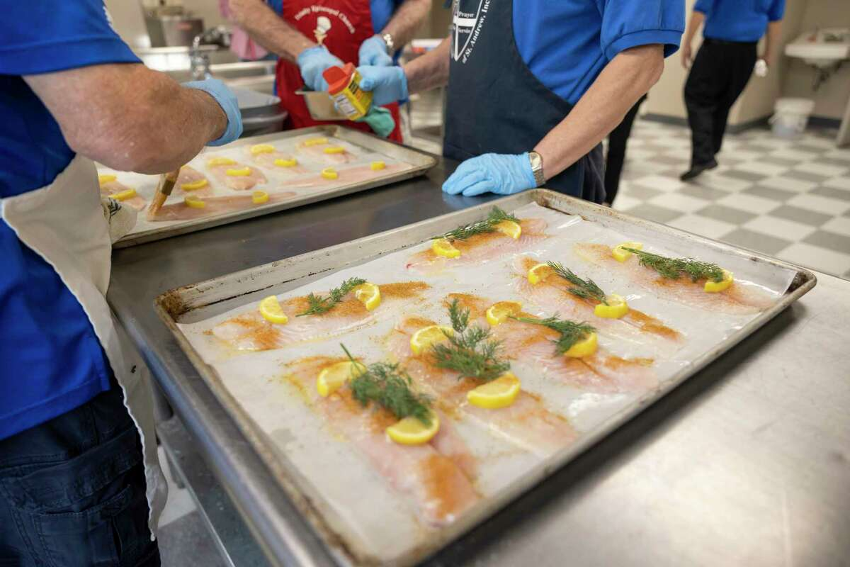 As seen, fish are set on an oven tray in preparation to be baked during an annual Lenten Fish Dinners at Trinity Episcopal Church, Friday, March 12, 2021, in The Woodlands. Fish dinners were distributed in a to-go style as a response to the ongoing COVID-19 pandemic.
