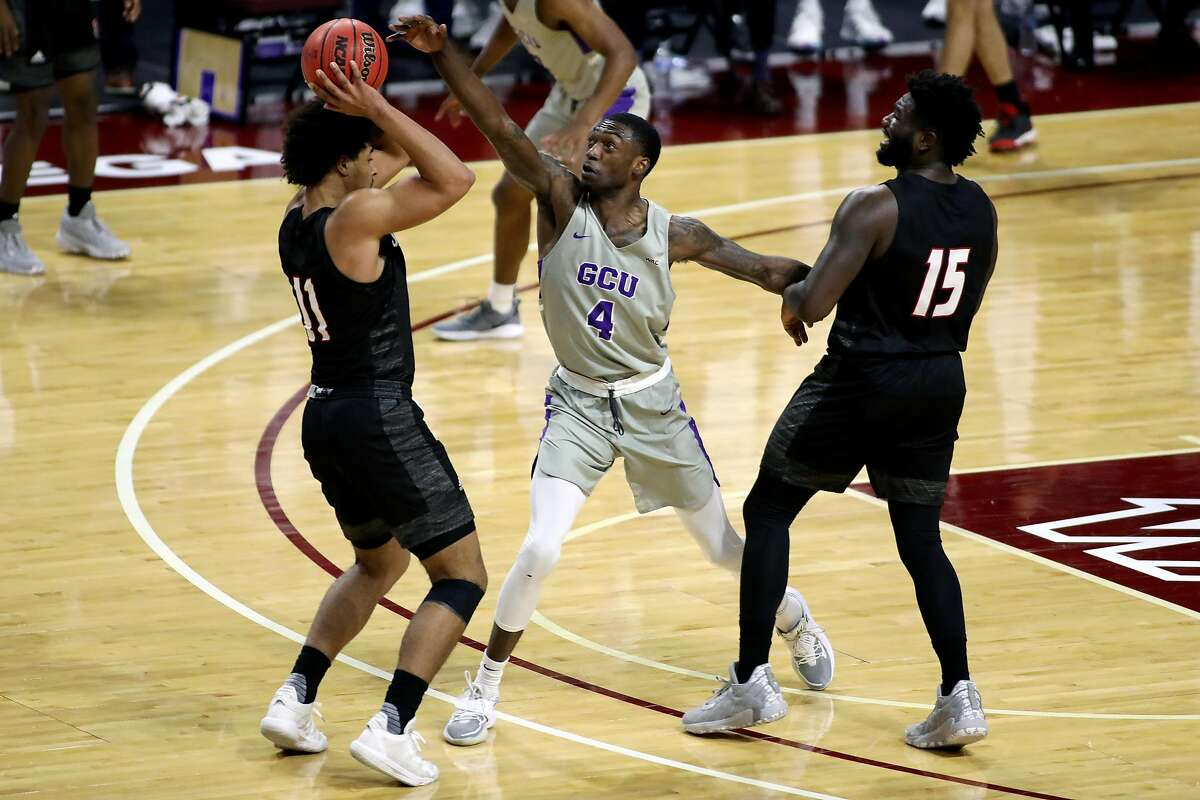 Grand Canyon University player Oscar Frayer (center), shown playing aggressive defense March 12 against Seattle University, died Tuesday after a car crash near Lodi.
