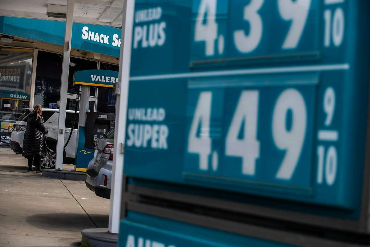 A motorist refuels a vehicle at a Valero gas station in San Francisco.