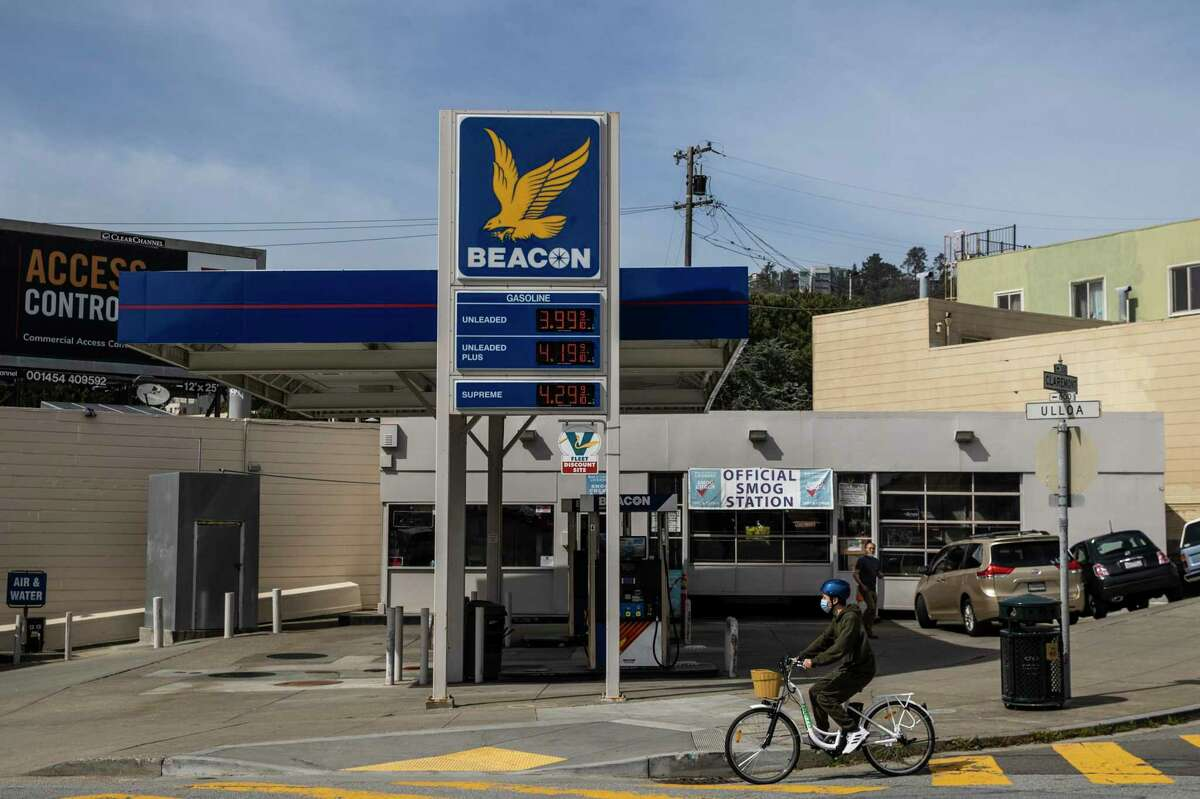 A bicyclist rides past a Beacon gas station in San Francisco in March. Mayor London Breed has proposed an ordinance that would make it easier for car-centric properties, like gas stations, to be converted into housing.