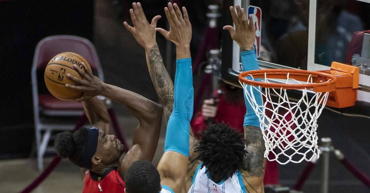 Houston Rockets forward Danuel House Jr. (4) shoots over Charlotte Hornets forward Miles Bridges (0) during the second quarter of an NBA game between the Houston Rockets and Charlotte Hornets on Wednesday, March 24, 2021, at Toyota Center in Houston.