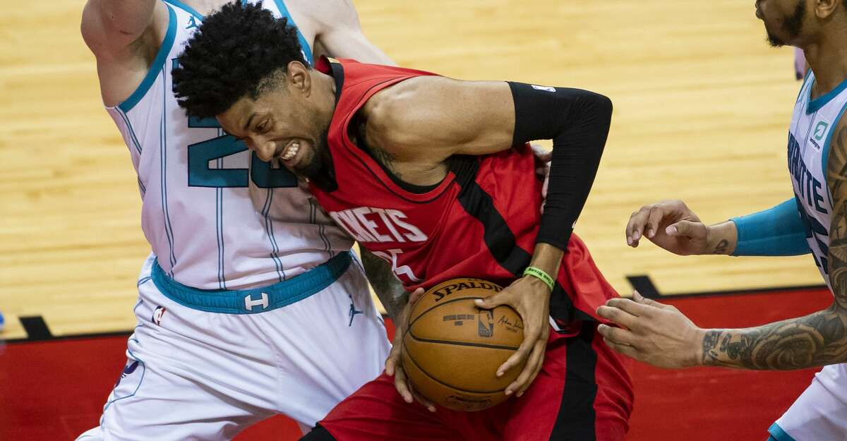 Houston Rockets center Christian Wood (35) drives into Charlotte Hornets forward Gordon Hayward (20) during the third quarter of an NBA game between the Houston Rockets and Charlotte Hornets on Wednesday, March 24, 2021, at Toyota Center in Houston.