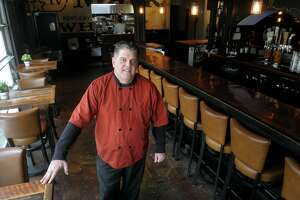 State Rep. David Rutigliano stands in the empty Sitting Duck Tavern, in Trumbull, Conn. April 10, 2020. Rutigliano owns several restaurants in southwestern Connecticut, and kept his restaurants open for pickup and online deliveries during the COVID-19 outbreak.