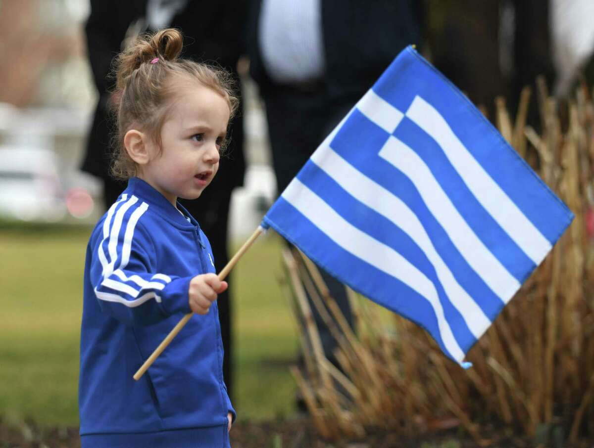 Greenwich's Peter Soterakis, 2, waves a flag during the Greek independence day flag-raising outside Town Hall in Greenwich on Thursday. The event marked 200 years of Greek independence and was well attended by local residents of Greek heritage. BET member Karen Fassuliotis and First Selectman Fred Camillo spoke at the event.